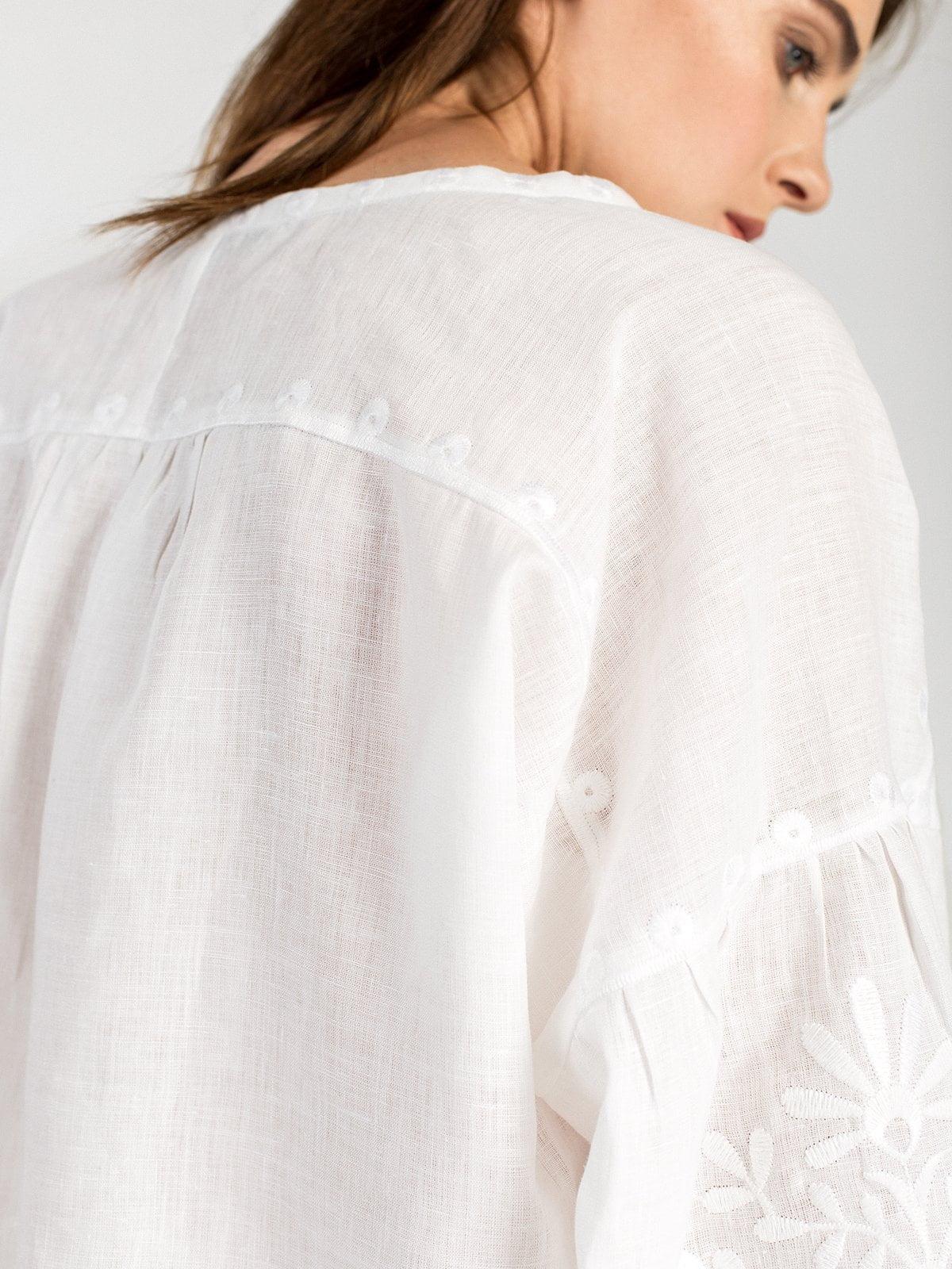 Жіноча вишиванка з пишними рукавами білого льону North Bird – купити ... c1c6fdfc9da61
